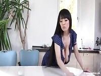 Seductive busty asian mature female Hitomi Tanaka is fingering her twat.